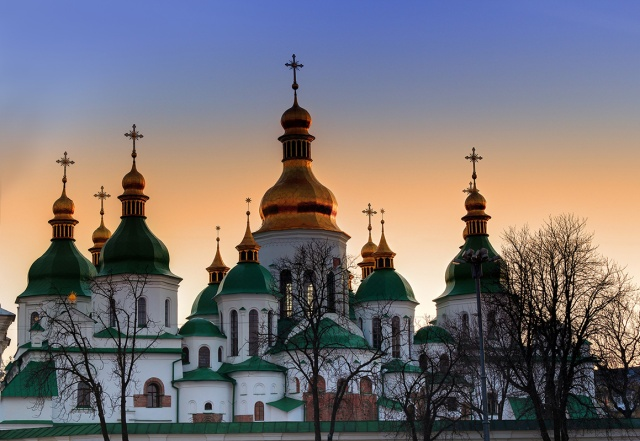 Domes of Saint Sophia Cathedral in Kiev over dramatic sunset sky